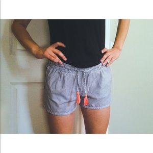 Pinstripe shorts with coral tassels